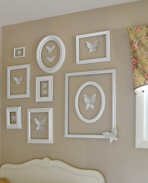I adore the book page butterflies accented inside the empty frames. Just  gorgeous! She painted all of the garage sale pictures accumulated over the  years ...