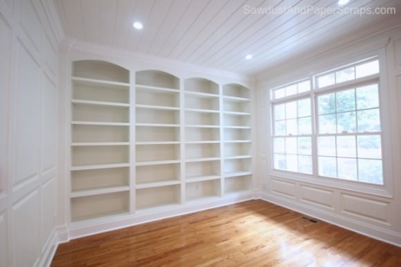 Library Built-ins & Wainscoting ~ Wall to wall book shelving with custom  bookshelves that don't have to break the bank. Learn how to build your own  with ...