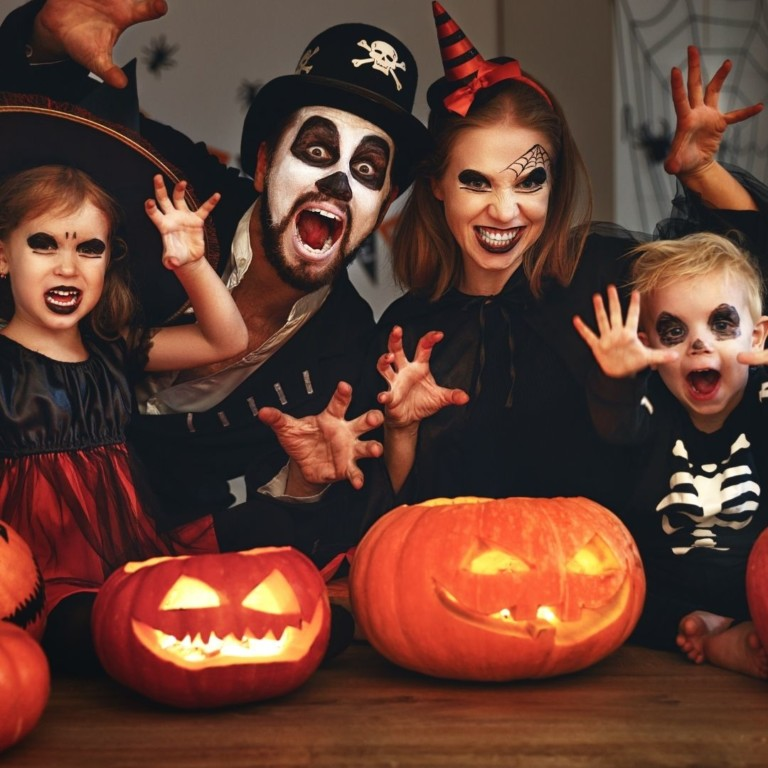 family at halloween party