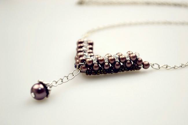 Make Your Own Charm Necklace Out Of Several Pearl Beads