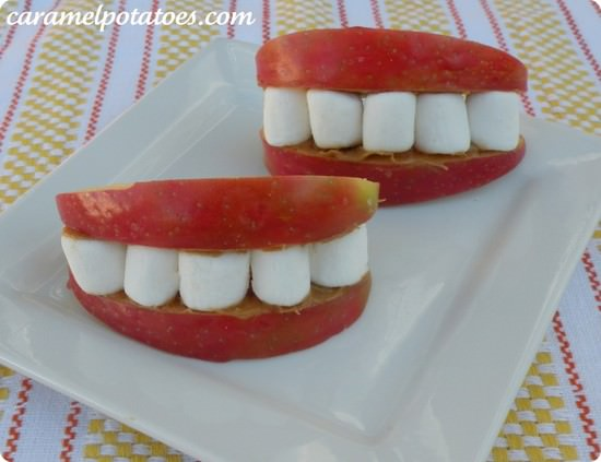 apples and mini marshmallows put together to make smiles