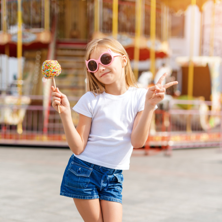 Girl eating candy apple