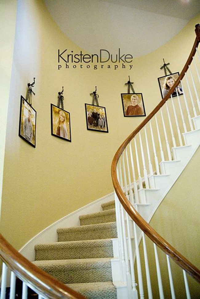 Great Decorating with Portraits Up the Stairs