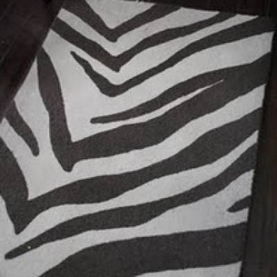 Make Your Own Zebra Rug {make a rug} {inspired by West Elm}