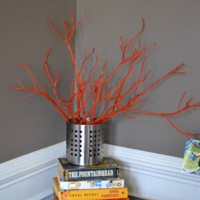painted sticks in a vase